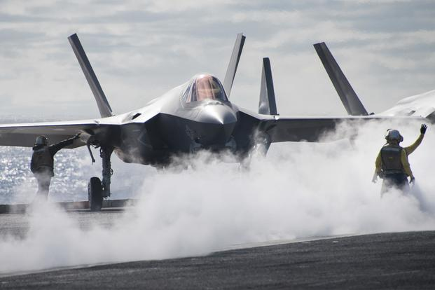 An F-35C performs flight operations aboard the USS Carl Vinson.