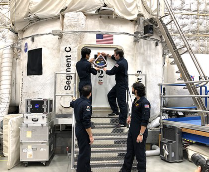 Image of astronauts going into quarantine - the need for AI for human health support